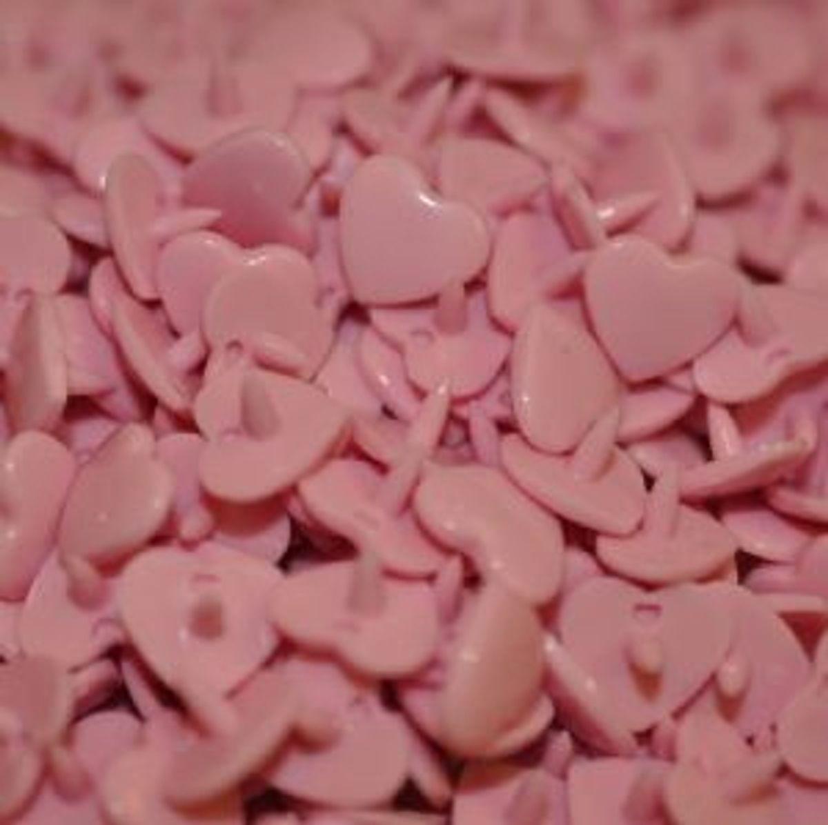 Sachet de 25 pressions résine coeurs - Rose